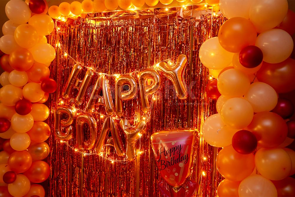 A Glorious Rosegold Happy Birthday Room Decoration to surprise your close ones at home.