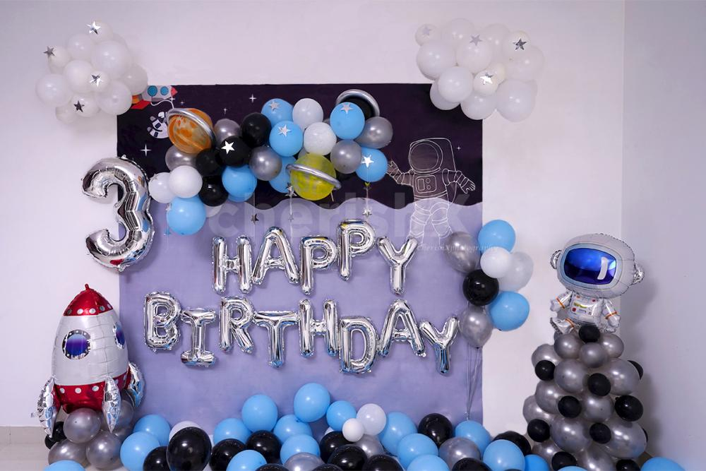 Celebrate your kid's birthday with this adorable Space themed birthday room decor.