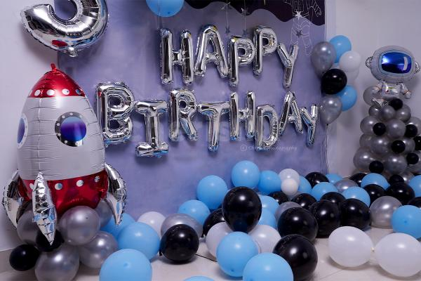 Surprise your kid with this balloons filled Birthday room decor.