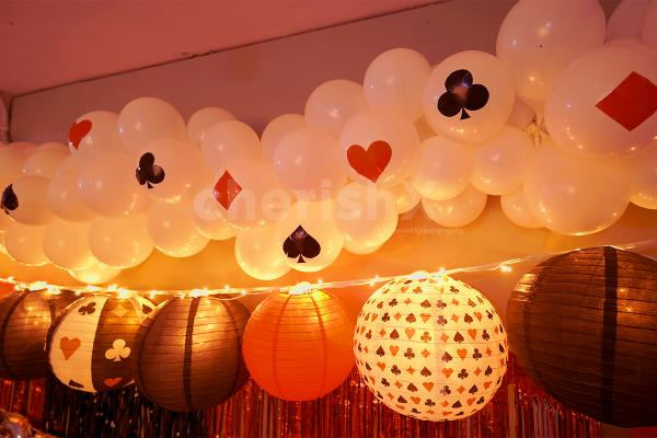 White balloon bunches stick together with 16 card stickers on them.
