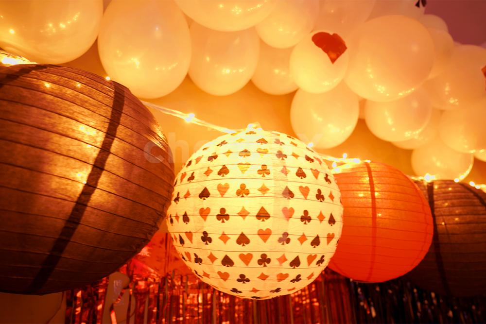 8 Poker Theme Lanterns put up on the ceiling to make the decor brighter.