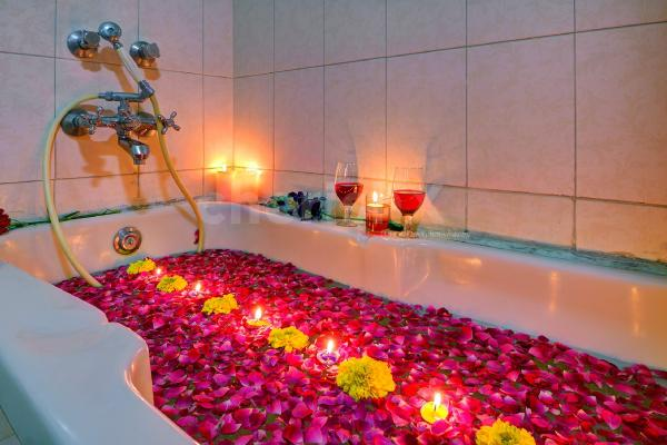 Daycation in a cabana suite with decorated bath tub and candlelight dinner in jaipur