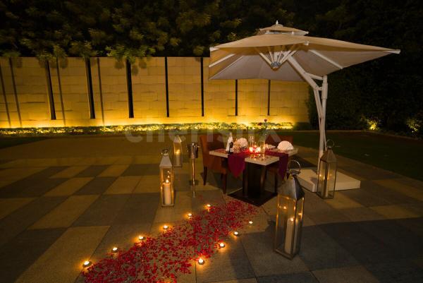 Romantic canopy dining by Taj