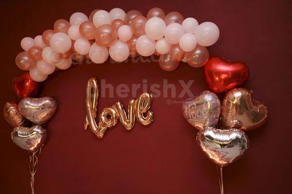 Hear shape balloons in silver, rose gold and red