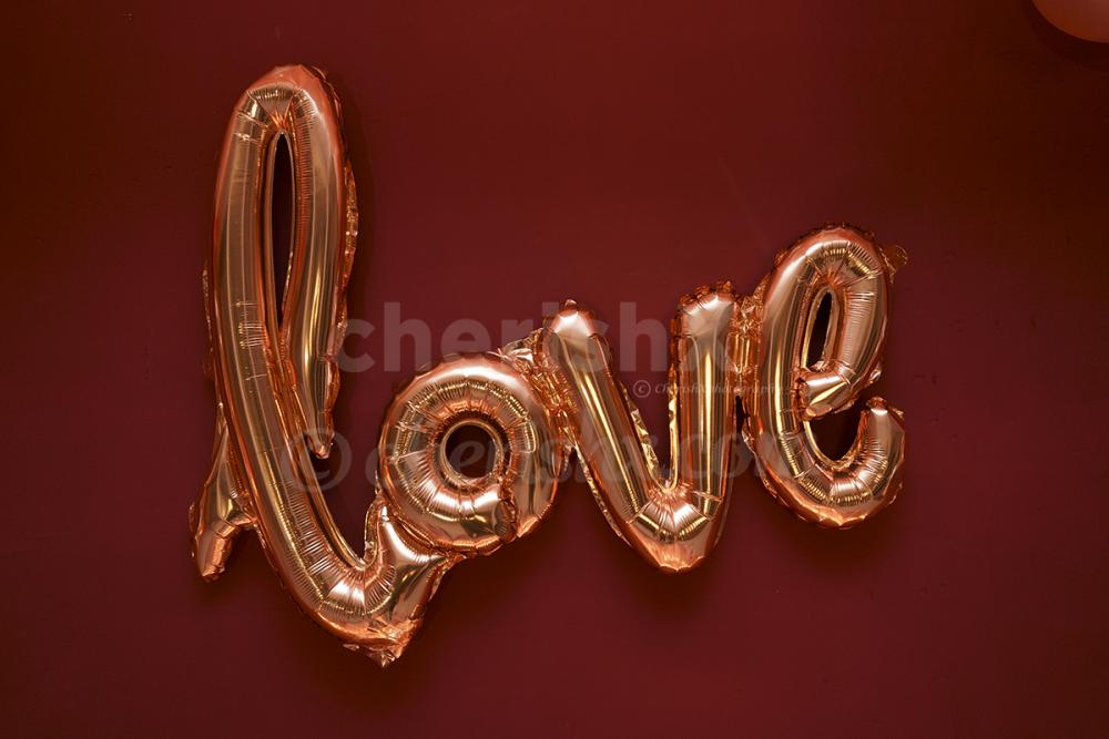 cursive love balloon in rosegold color