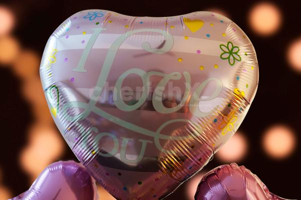 A pink big heart-shaped foil balloon of 'I Love You' to take your love by surprise.