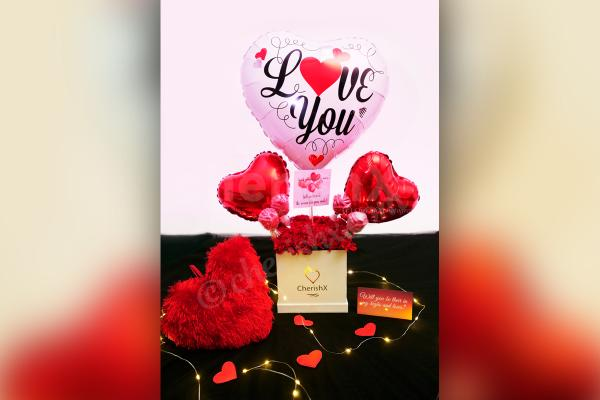 Give a lovely surprise with CherishX's White & Red Colored Rose Day Bucket!