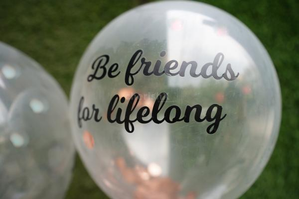 """""""Be Friends for lifelong"""" a promise printed on a helium confetti balloon."""