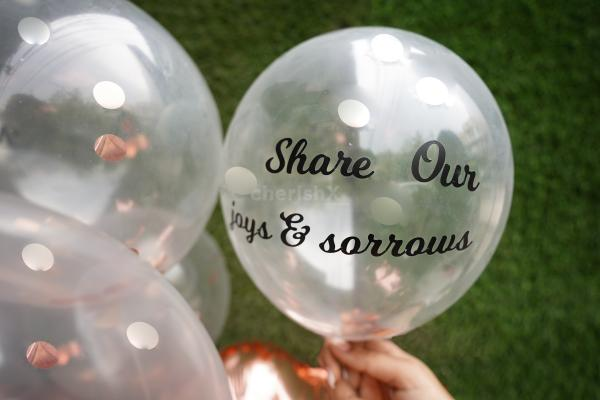 """One of the 7 balloons with the promise """"share our joys and sorrows""""."""