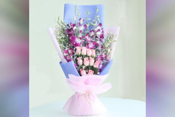 6 Purple Orchids and 10 Pink Roses in a Paper Bouquet