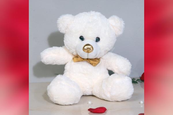 A white teddy of 12' ft that you can gift with a bouquet of roses.