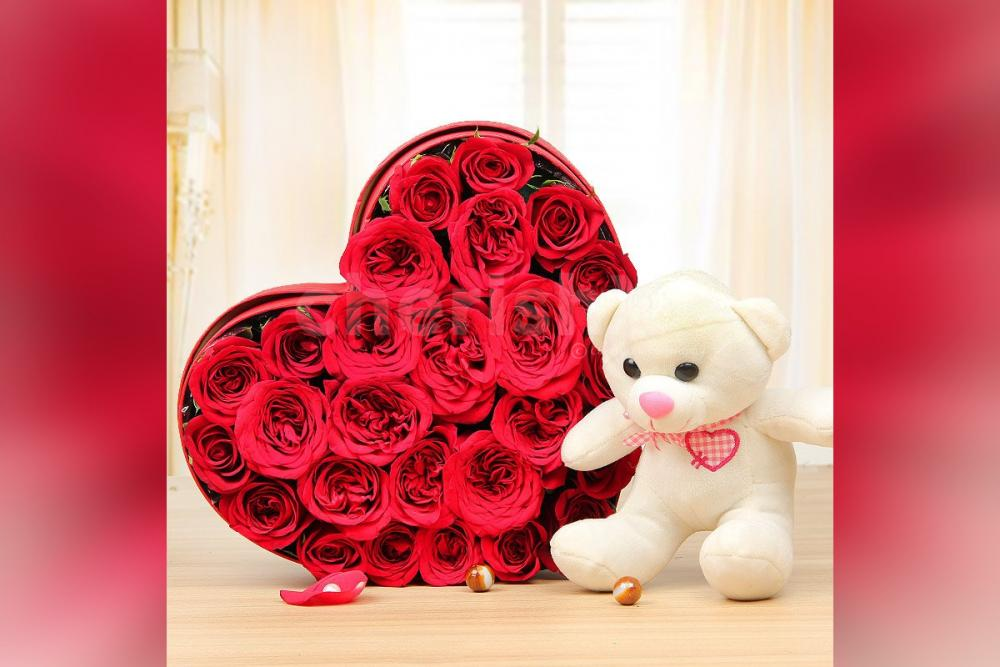 A 25 Red Rose arrangement in a heart shape and a 6' ft white teddy.