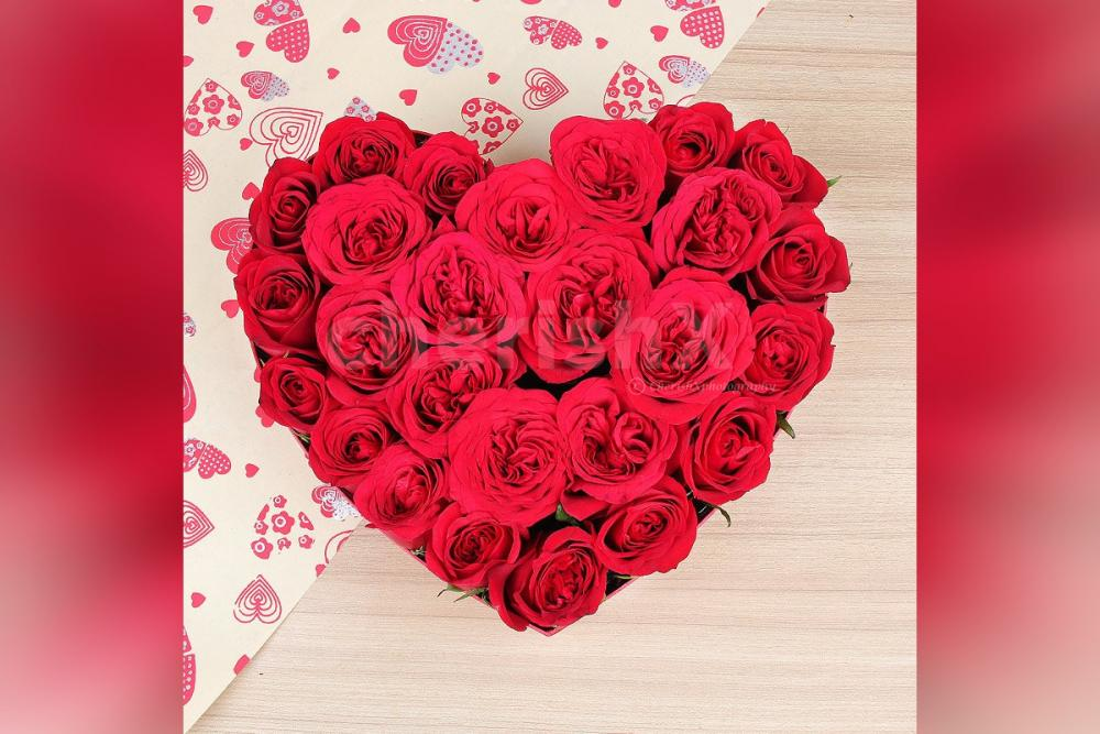 25 Red Rose arrangement in the shape of a heart.