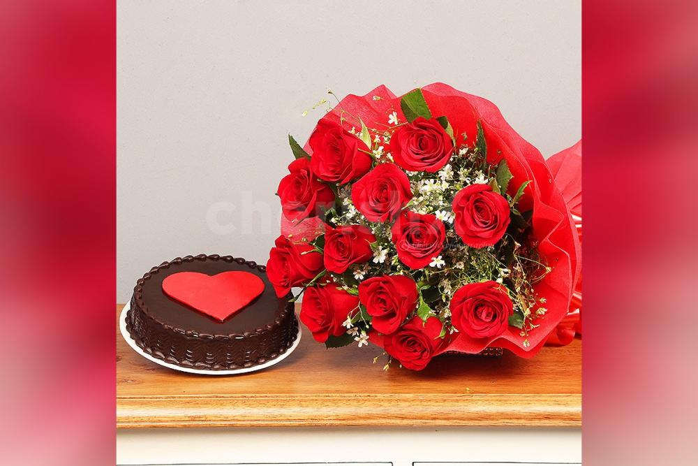 Send a simple 12 Red Rose with a delicious Chocolate Cake with a Red Heart.