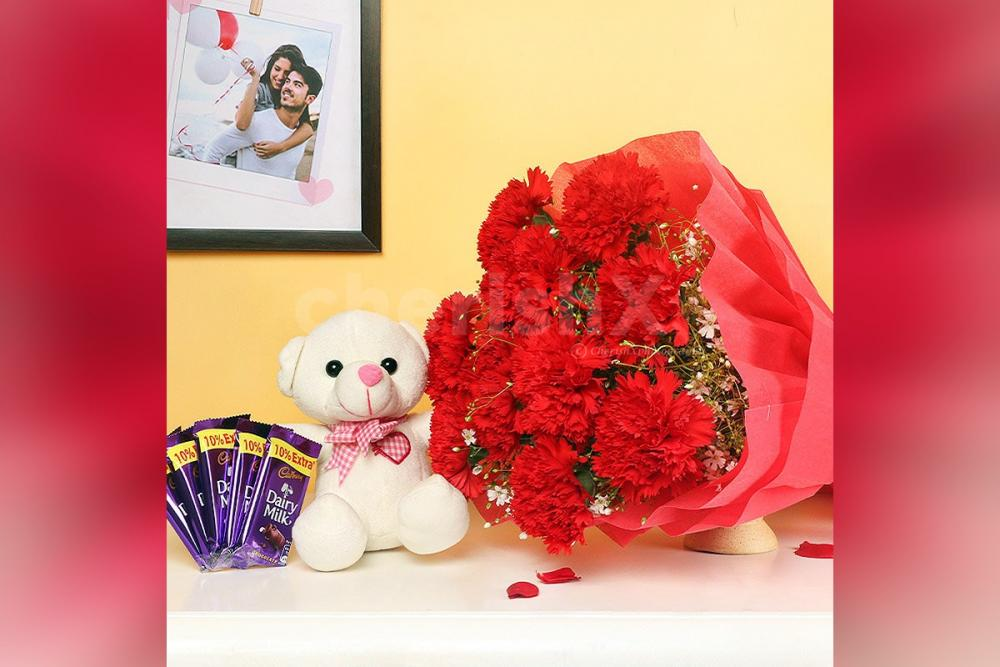 A Combo with 10 red carnations with 5 dairy milk chocolates and a 6' ft cute teddy.