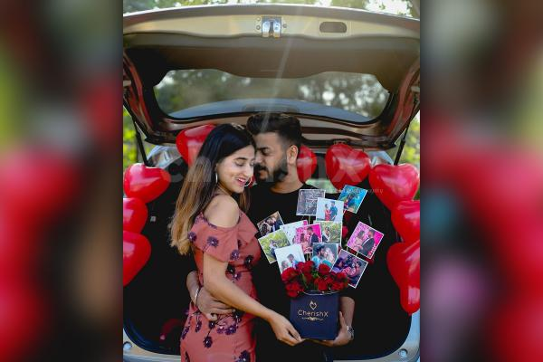 A loving couple with CherishX's Rose Bucket with photos.