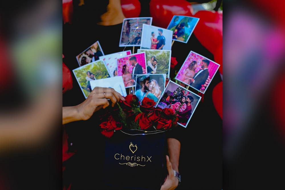 Beautiful photos set up in the bucket with roses to give a wonderful look to the gift.