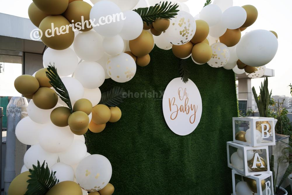 CherishX's Golden and White Baby Shower Decor lets you have a grand celebration. So, book this lovely decor to make your celebrations lovely!