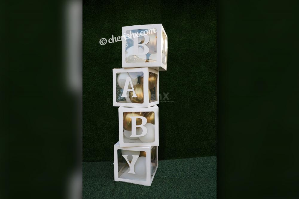 Book CherishX's Golden and White Baby Shower Decor to celebrate the birth of your child in a grand manner!