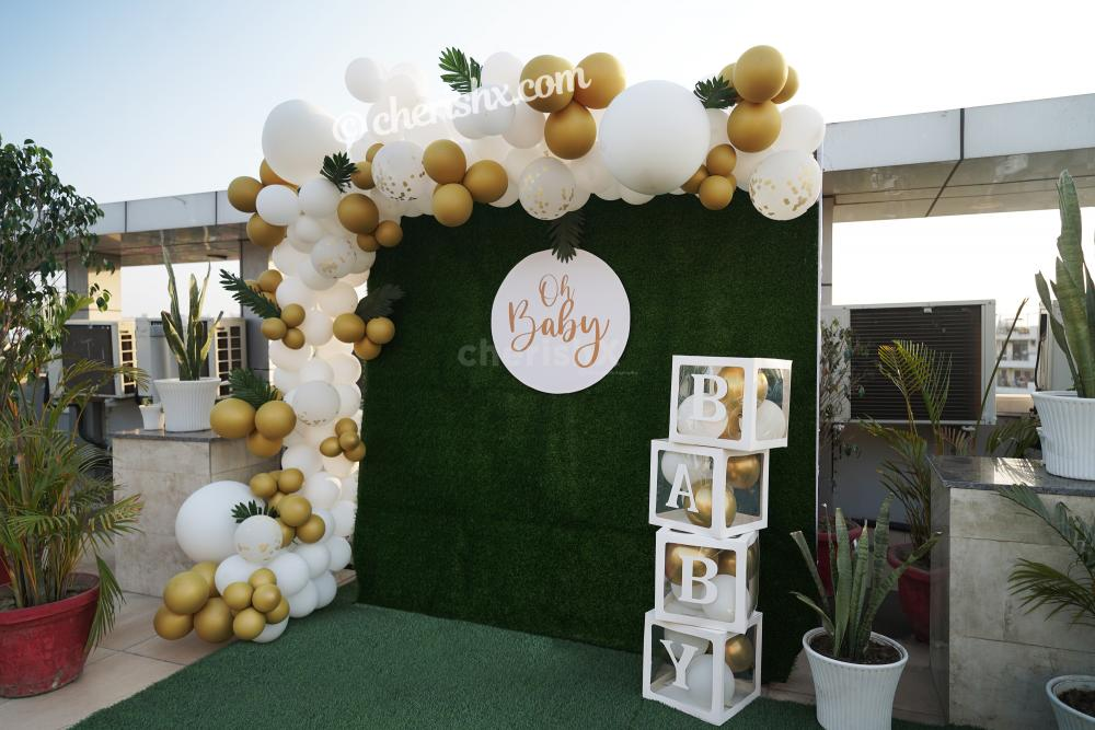 Celebrate the birth of your child with these bright Golden and White Baby Shower Decor!