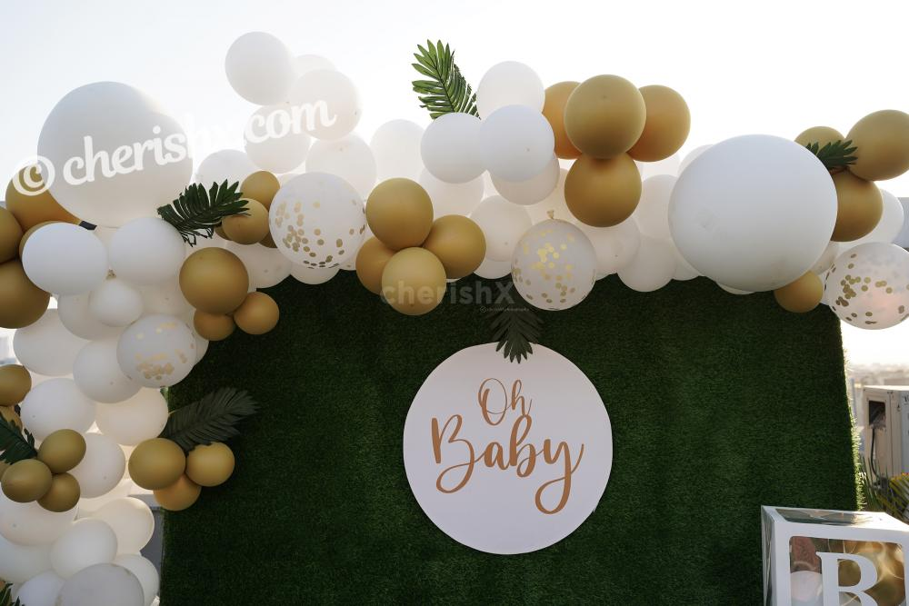 Celebrate the birth of your child with this loving CherishX's Golden and White Baby Shower Decor!