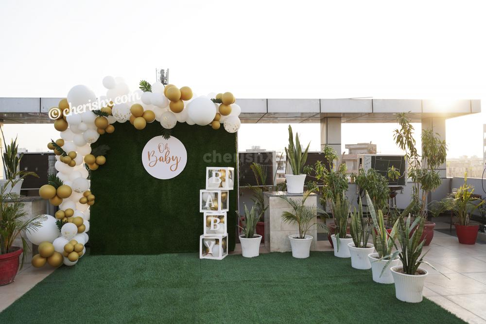Golden and White Baby Shower Decor