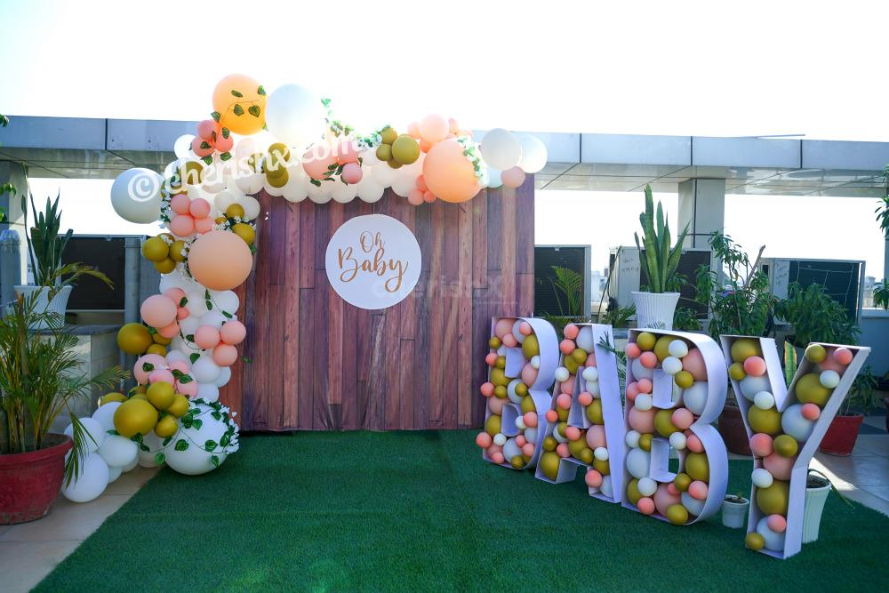 Celebrate the birth of your child joyously by booking CherishX's Peach Colored Baby Shower Decor!