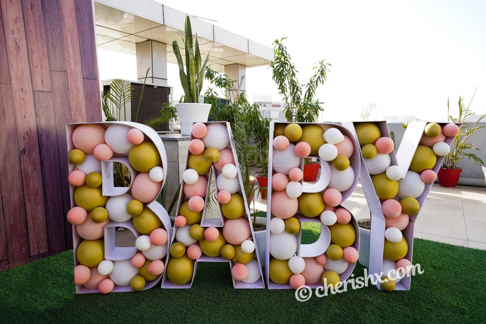 """Book a Charming Peach Colored Baby Shower Decor to throw a grand baby shower for the """"mother to be""""!"""