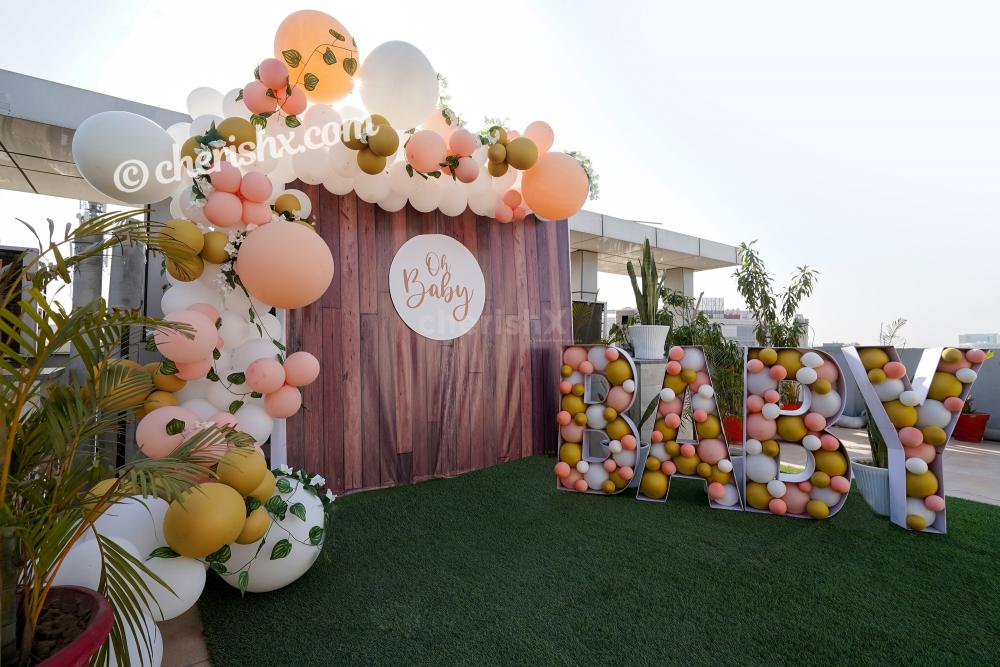 Throw a lovely Baby Shower for you close ones by booking CherishX's Peach Colored Baby Shower Decor !