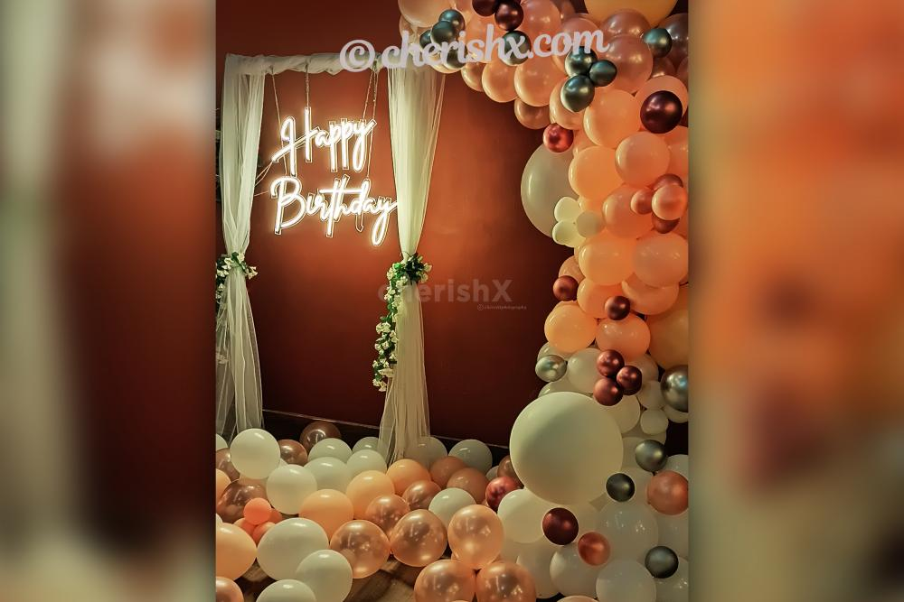 Add wonderful neon light decoration with pastel and chrome balloons to your birthday party
