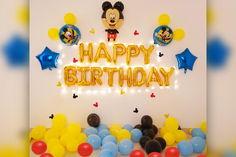 Celebrate your kid's birthday with a Famous Mickey Mouse Birthday Surprise decor!