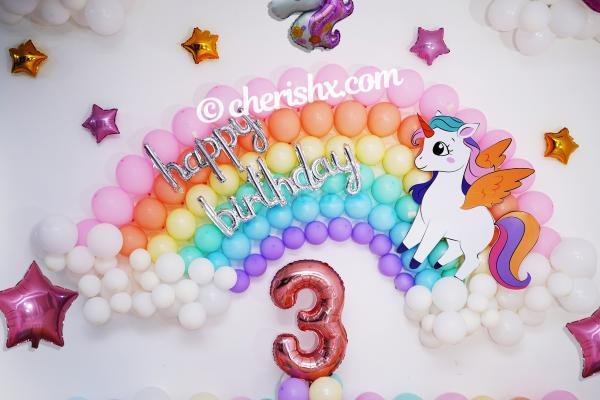 Throw a party to celebrate your child's birthday with colourful unicorn balloon decoration.
