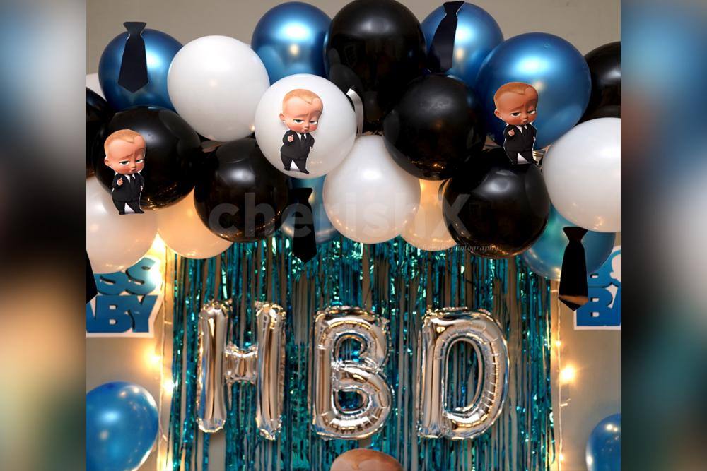 The decor includes frills, balloons and cutouts to give a charming look!