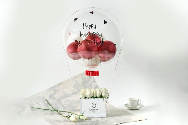 Rose Gold Balloon Bucket with White Roses