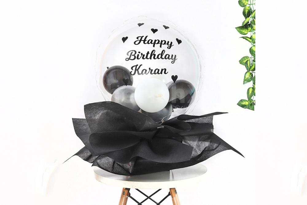 Wish a happy birthday to your close one with this fascinating Black Balloon Bucket!