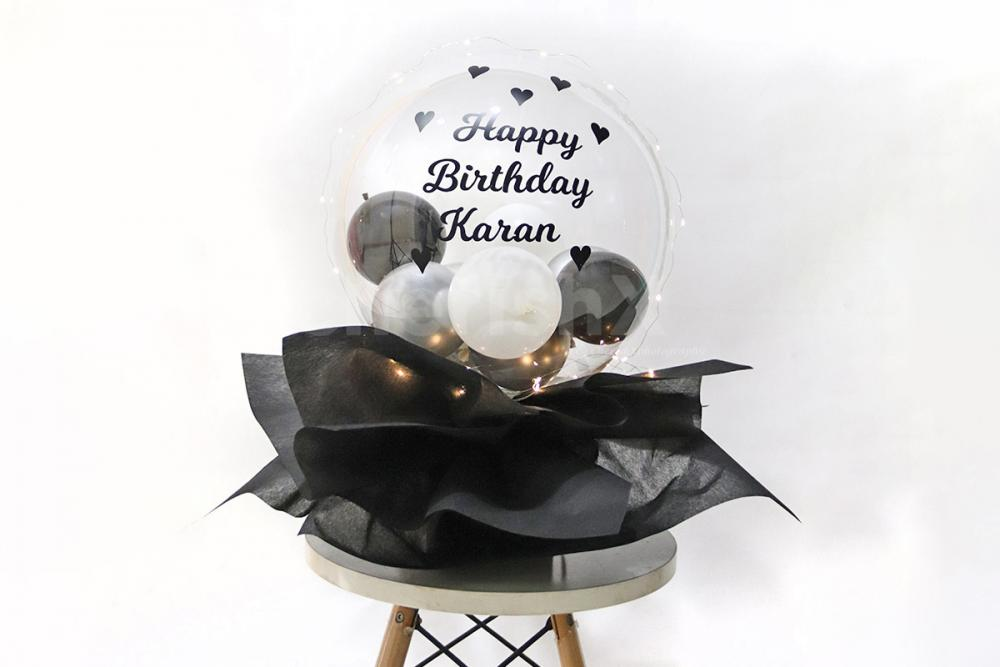 Planning to give something to your partner on anniversary? Well, then give this beautiful black balloon bucket to make it memorable!
