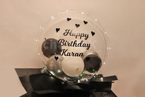 Get this big balloon bucket filled with many small balloons to surprise your love!