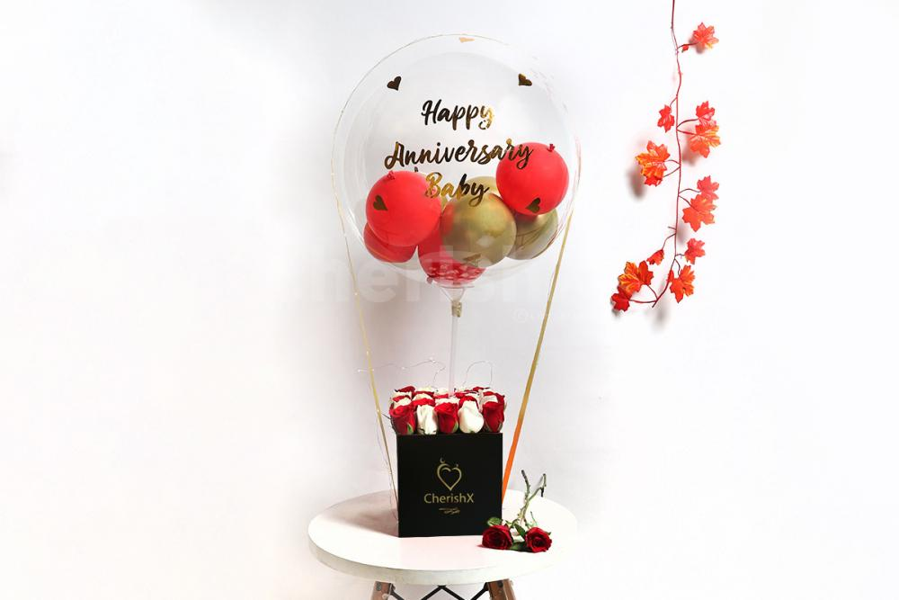 A heart-warming balloon bucket filled with white and red roses!