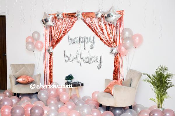 CherishX's Happy Birthday Rose Gold Surprise Decor with rosegold and metallic balloons.