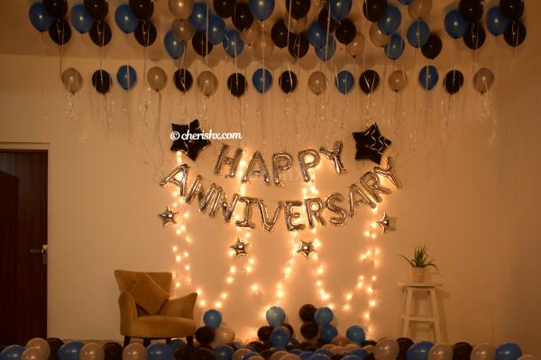 Make your close ones feel special with this elegant Blue & Silver Themed Anniversary Decor!