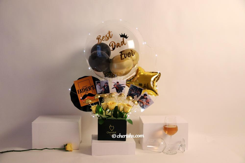 A Black & Gold Father's Day Bucket with Balloons and Chocolates!