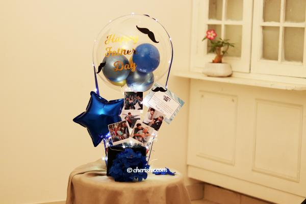 CherishX offers you this wondrous Blue & Gold Father's Day Bucket to make him feel extra special!