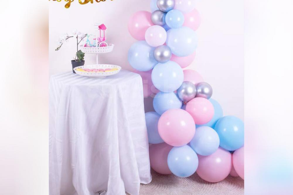 Gift the mom-to-be a pleasant surprise by booking CherishX's Pastel Balloons Baby shower decor!