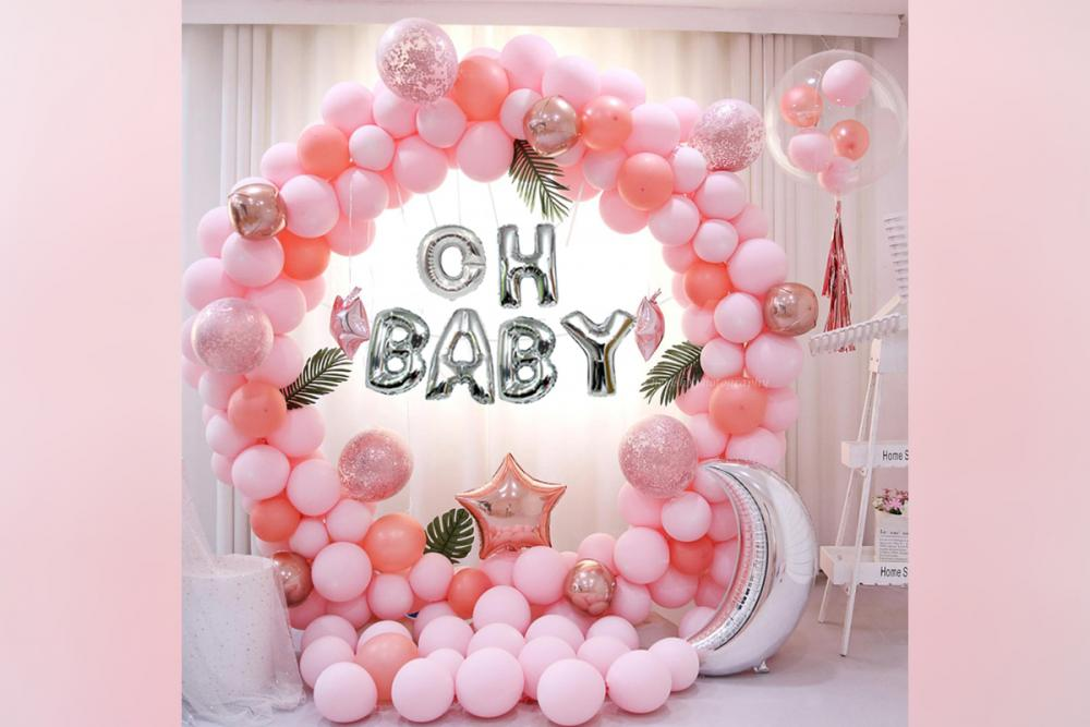 A beautifully curated baby shower decor in shades of pink.