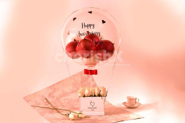 Express your warm feelings with CherishX's Rose Gold Balloon Bucket with White Roses!