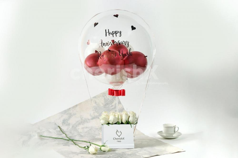 Rosegold Balloon bucket with white roses delivery in Bangalore