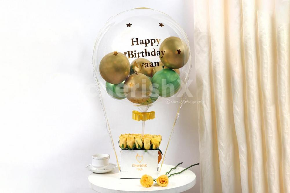 Send wishes with this extraordinary Gold & Green Balloon Bucket delivered anywhere in Bangalore