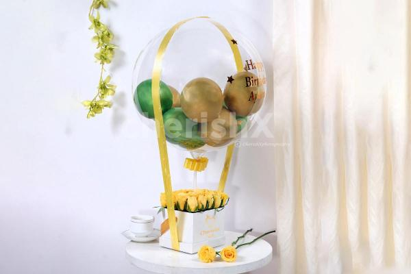 Startle your special one by gifting this beautiful Gold & Green Balloon Bucket with Chocolates!