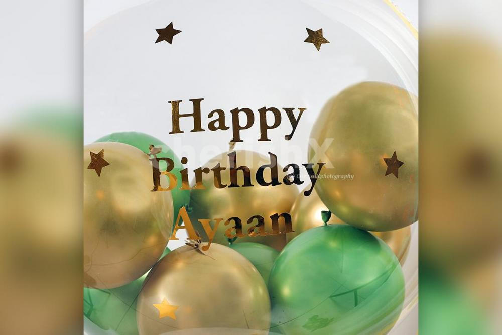 CherishX's Gold & Green Balloon Bucket with Chocolates is designed to bring joy to the face of the recipient!