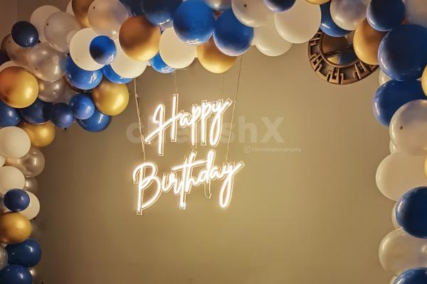 Add wonderful neon light decoration with blue and chrome balloons to your birthday party